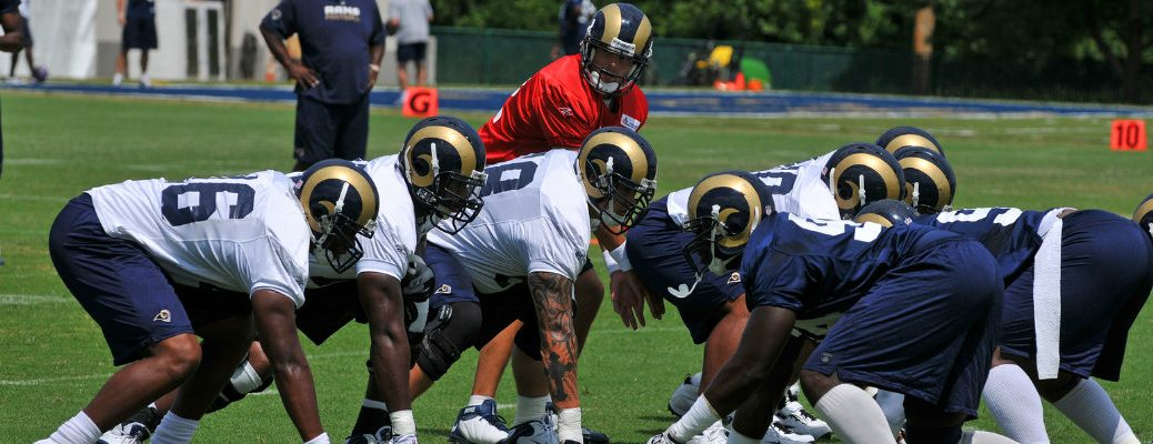 Offensive and defensive lines of Los Angeles Rams with quarterback under center