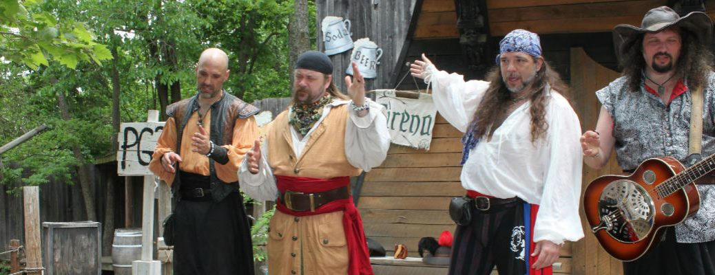 Four men dressed as pirates for outdoor pirate party