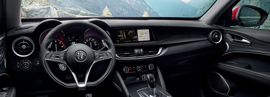 front interior of 2019 alfa romeo stelvio including steering wheel and infotainment system