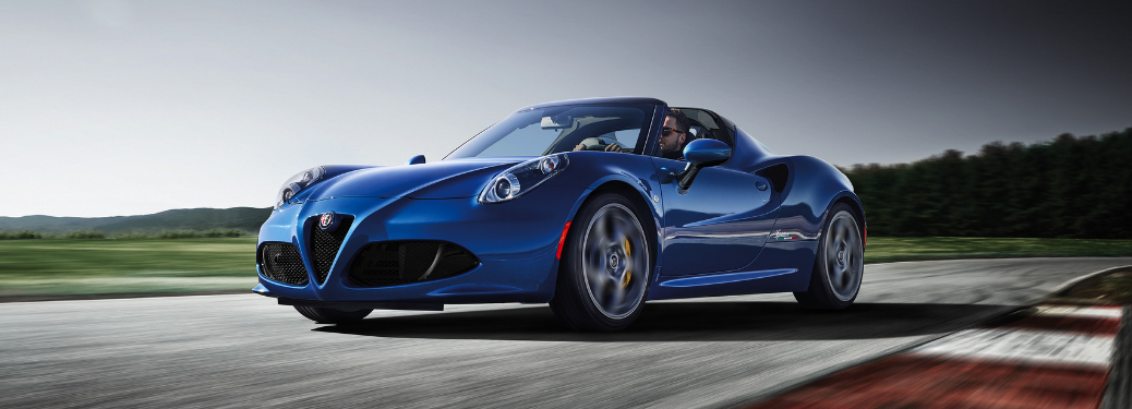 front and side view of blue 2020 alfa romeo 4c spider italia on racing track