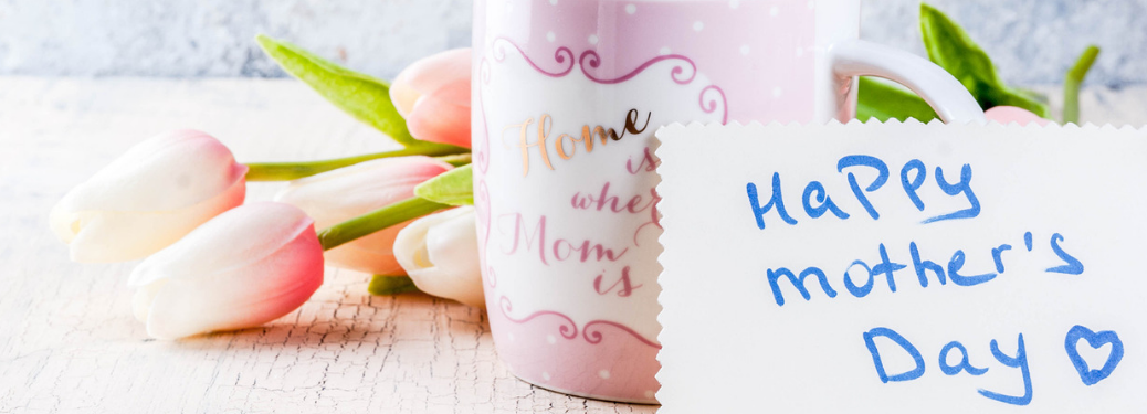 """card reading """"happy mother's day"""" next to coffee mug and flowers"""""""