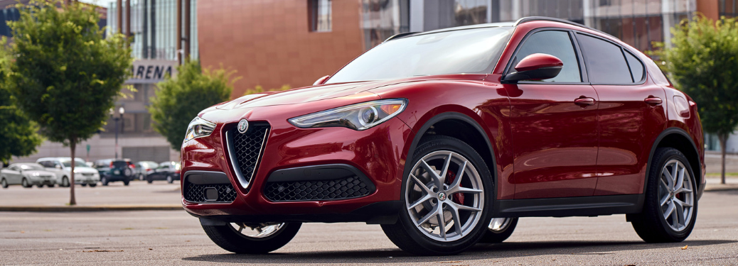 front and side view of red 2019 alfa romeo stelvio