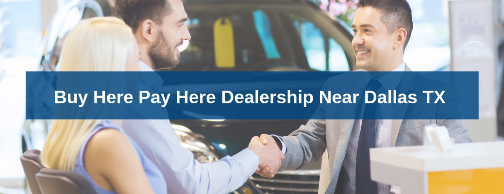 """Salesman shaking mans hand while talking to couple with """"Buy Here Pay Here Dealership Near Dallas TX"""" white overlay text"""