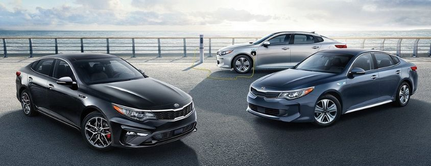Exterior view of three different 2019 Kia Optima models