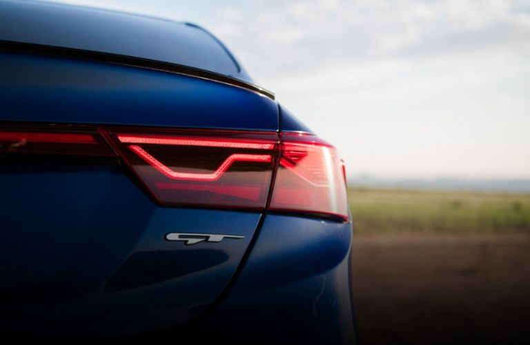 Exterior view of rear taillight and badging on a blue 2020 Kia Forte GT