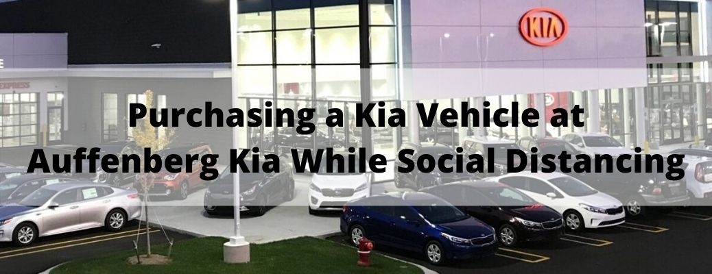 Purchasing a Kia Vehicle at Auffenberg Kia While Social Distancing banner with a Kia dealership in the background