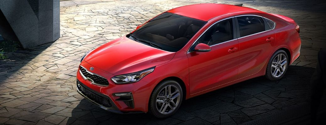 Exterior view of a Currant Red 2020 Kia Forte