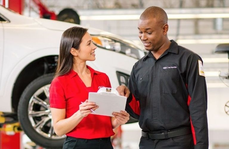 Image of a Toyota service technician discussing the multi-point inspection with an associate