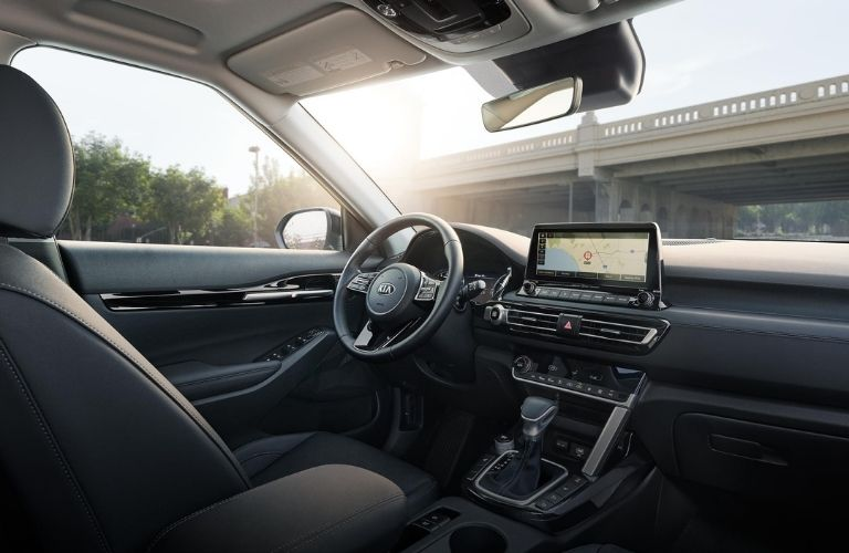 Interior view of the front seating area inside a 2021 Kia Seltos