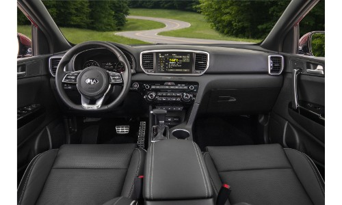 2021 Kia Sportage interior shot of front seating, steering wheel, and dashboard layout design