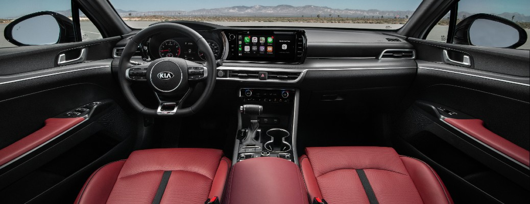 2021 Kia K5 GT interior shot of front seating, steering wheel, and infotainment system dashboard