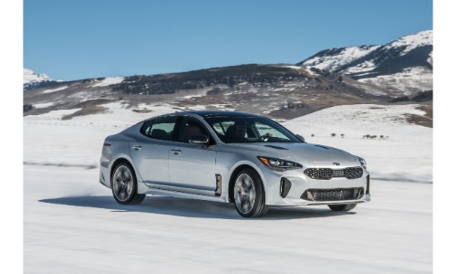 2019 Kia Stinger exterior shot with silver paint color parked on an icy and snowy tundra