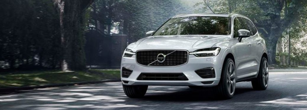 new volvo xc60 model driving in neighborhood