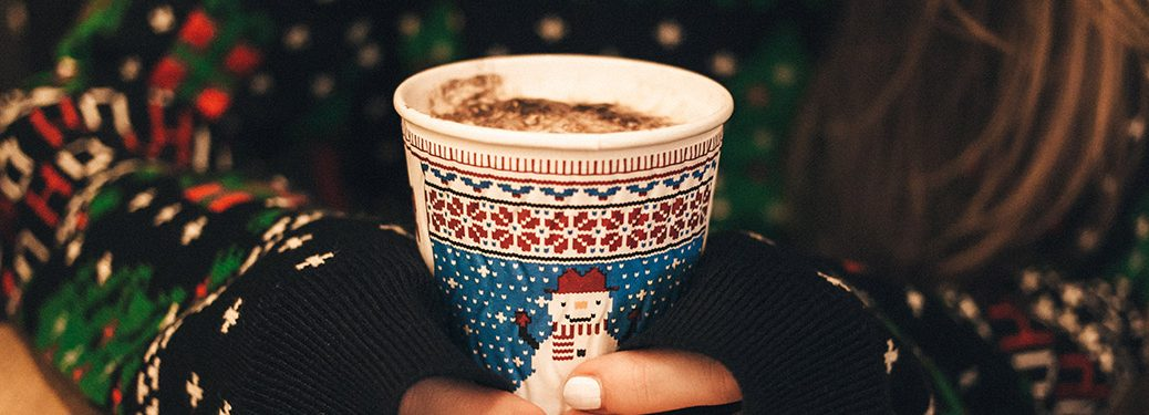 woman holding hot chocolate