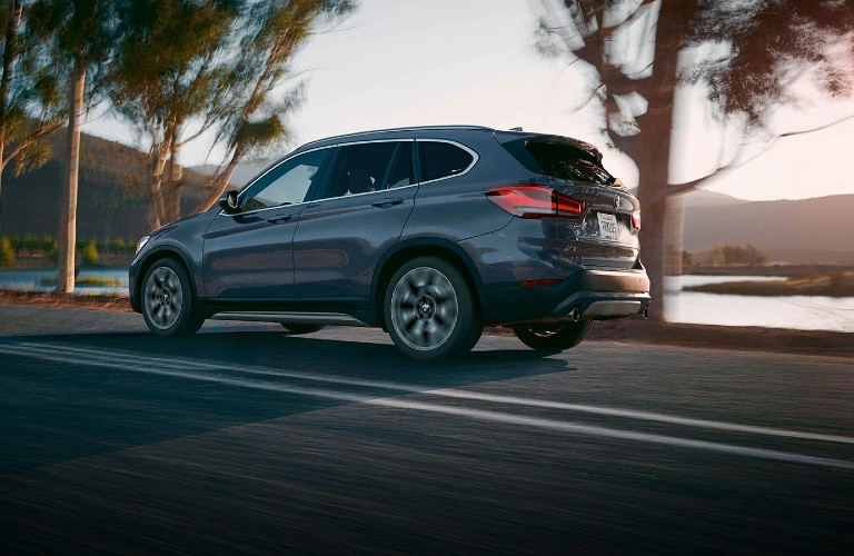 2020 BMW X1 driving down scenic road