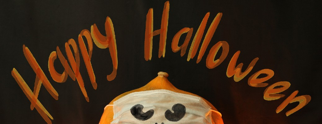 "pumpkin with mask on with the words ""happy halloween"""