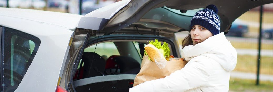 woman filling up vehicle with food