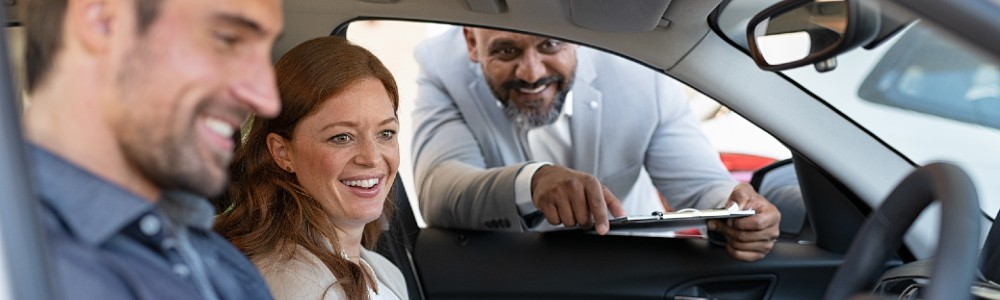 couple test driving car