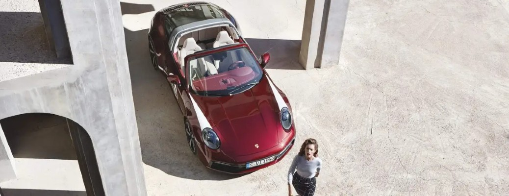 woman walking away from the Porsche 911 Targa Heritage Design Edition