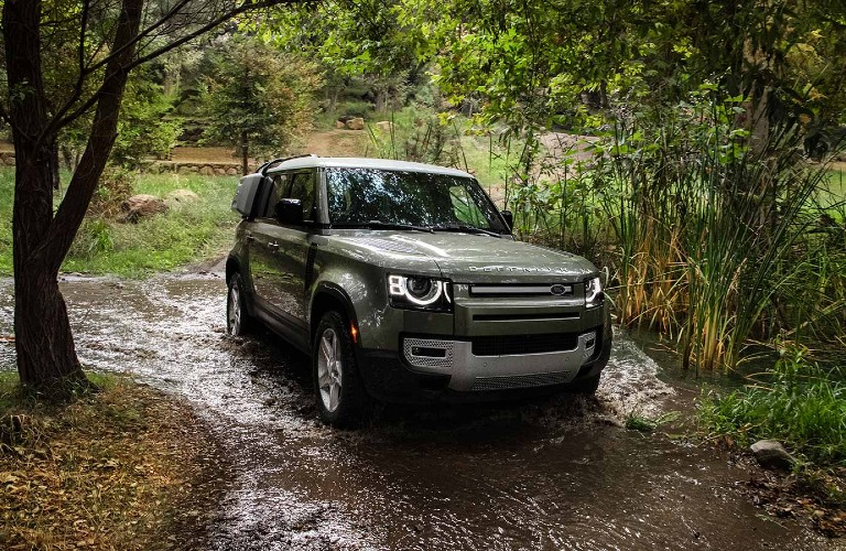 2021 Land Rover Defender driving through water