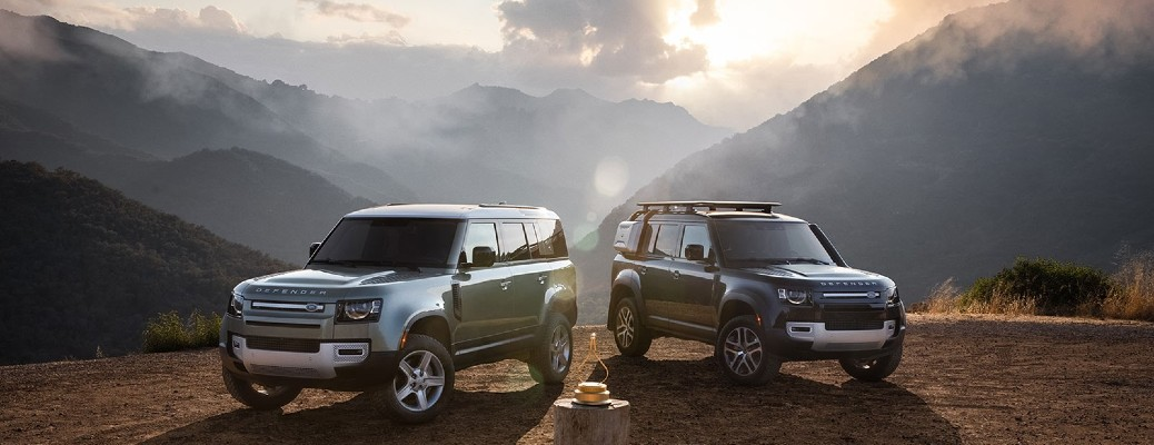 two Land Rover models parked next to each other