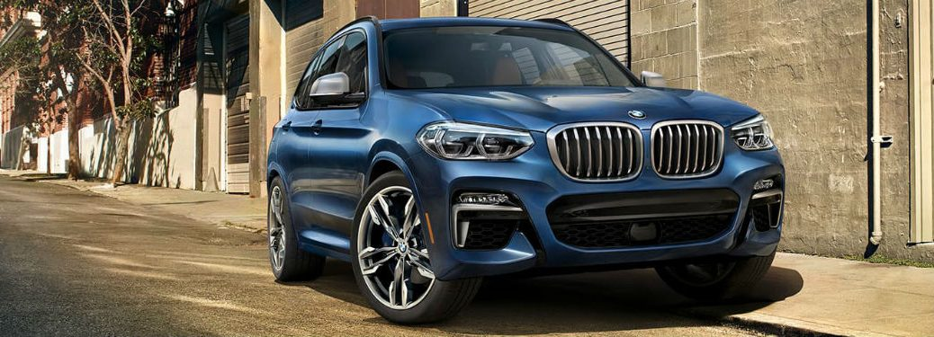 front view of a blue 2020 BMW X3