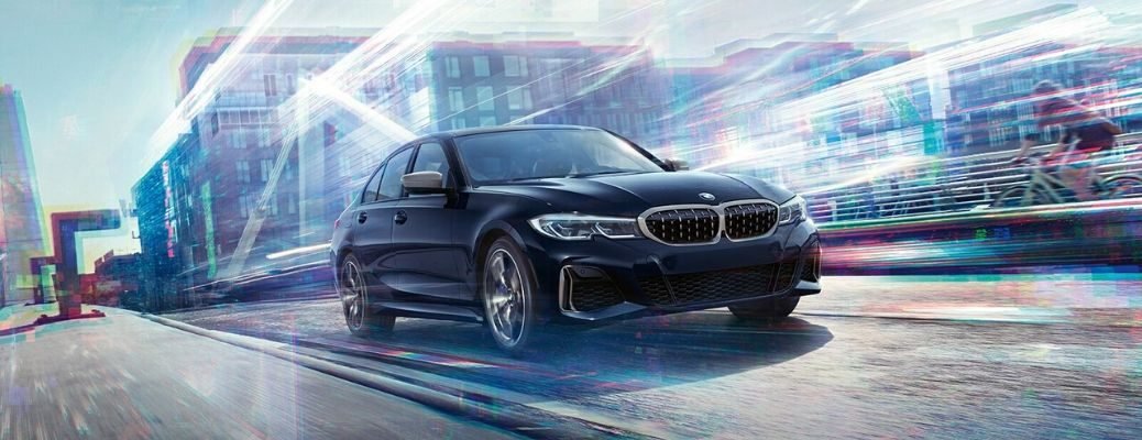 2020 BMW 3 Series sedan driving the road