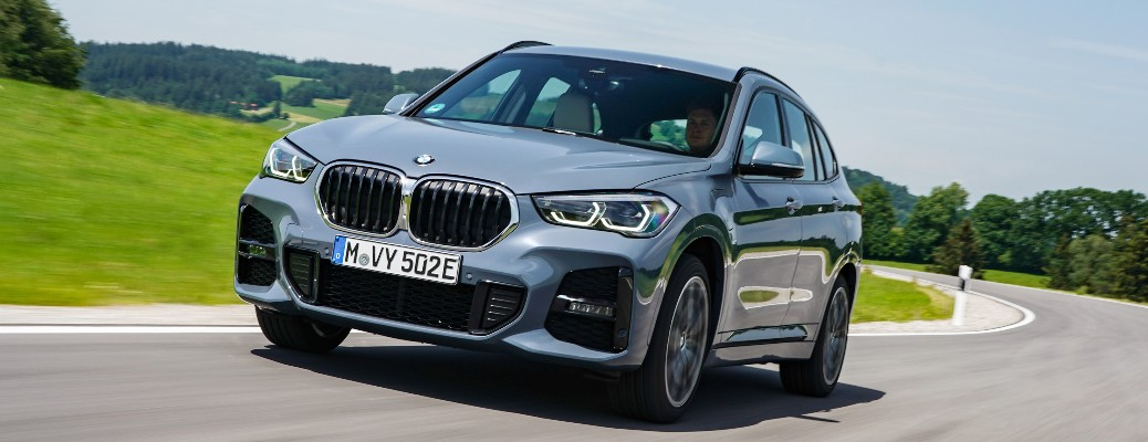 2021 BMW X1 driving around curved road