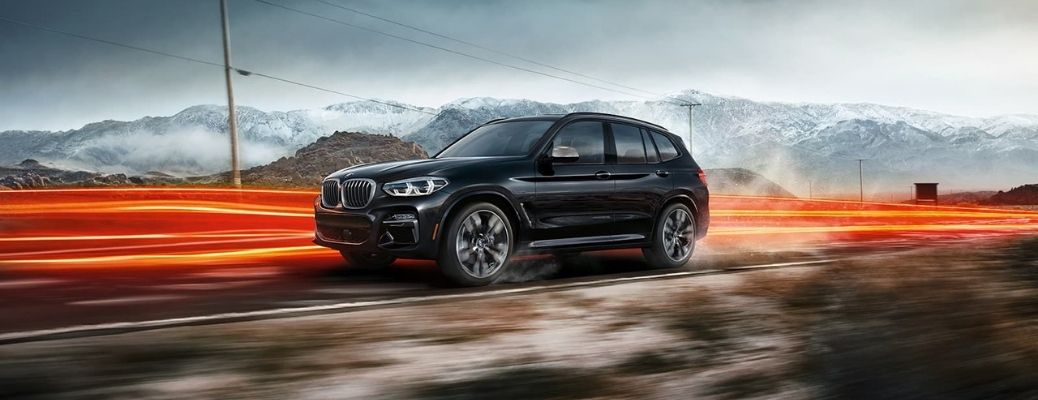 2021 BMW X3 black side and front view