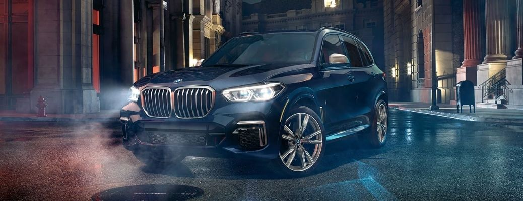 2021 BMW X5 on road in the night