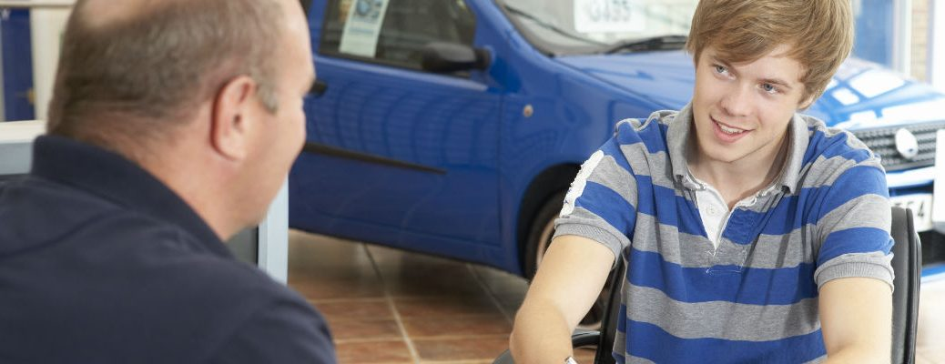 A stock photo of a customer working with a dealership representative.