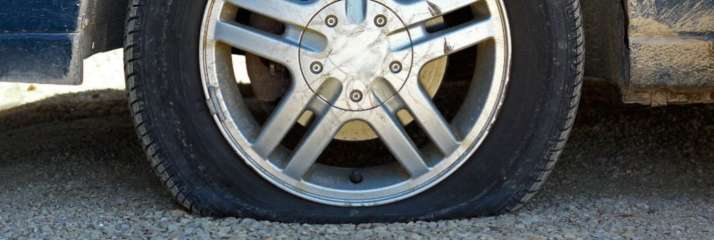 close-up look at a flat tire on a generic vehicle