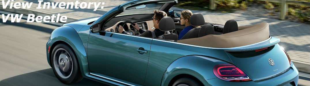 Volkswagen Beetle Convertible driving on a road