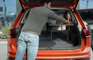 Man putting a table in the back of a 2019 Volkswagen Tiguan