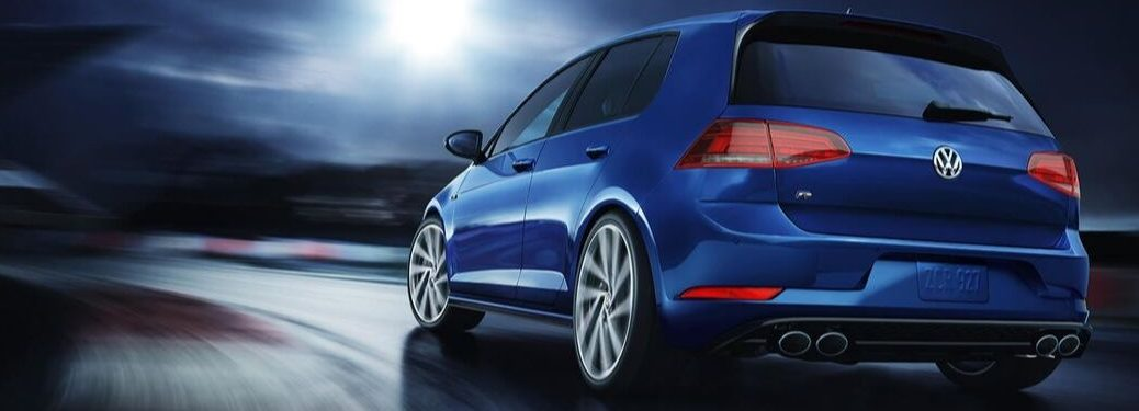 rear-view-of-blue-2019-Golf-R-driving-around-curve-at-night
