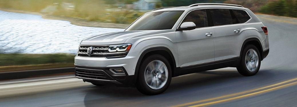2019 VW Atlas driving on highway next to body of water
