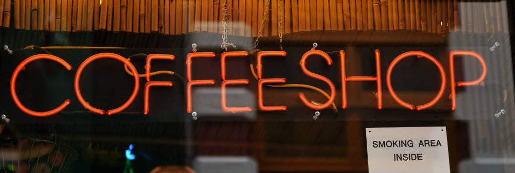 neon coffee shop sign in a window