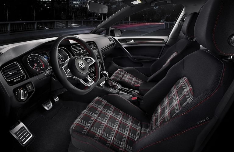 front seat interior view with clark plaid cloth seats in the 2021 VW Golf GTI