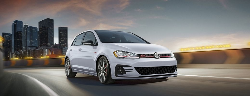 front and side view of the 2021 VW Golf GTI at sunset