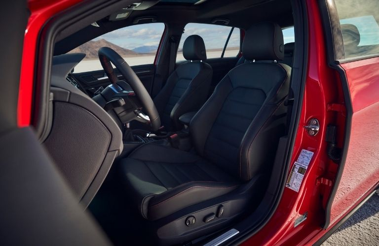 front seat view of the 2021 VW Golf GTI with the door open