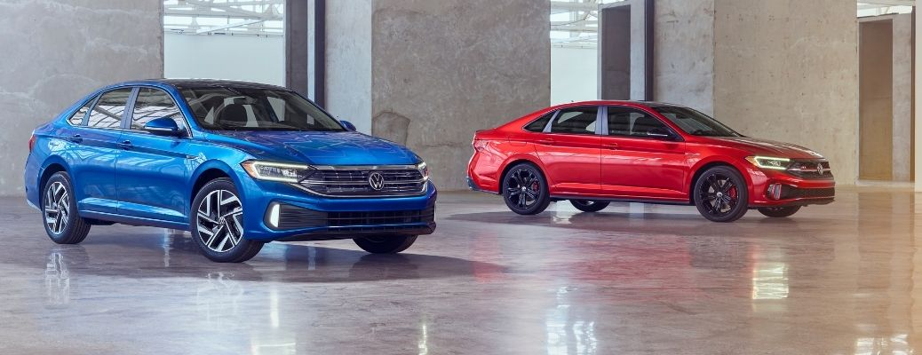 front quarter view of the 2022 VW Jetta and Jetta GLI parked parallelly at a distance from each other