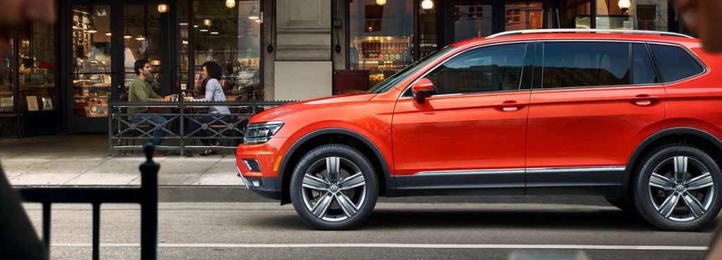 side-profile-of-red-orange-2019-Volkswagen-Tiguan-parked-on-city-street