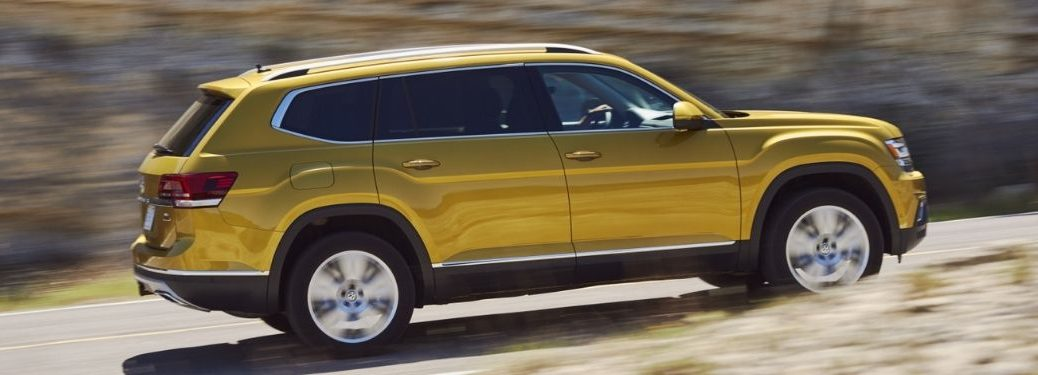 side-view-of-gold-VW-Atlas-driving-on-highway