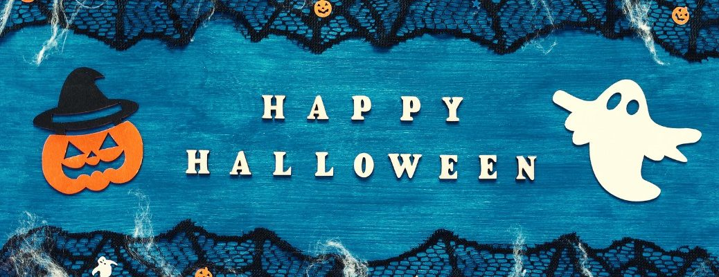 Happy Halloween title with jack-o-lantern and ghost over blue background