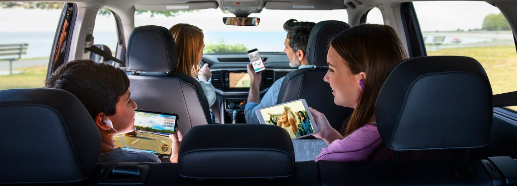 A family using their mobile devices inside of a 2020 Volkswagen vehicle