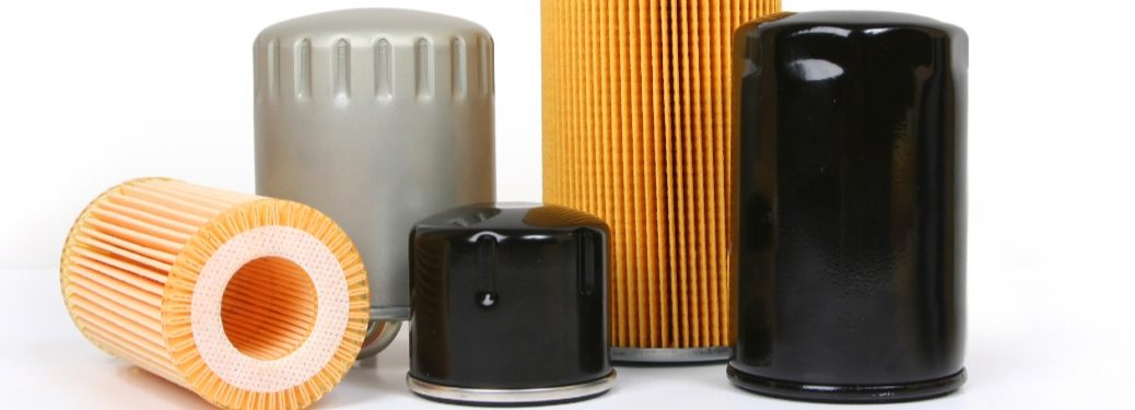 Several different oil filters exist against a white background.
