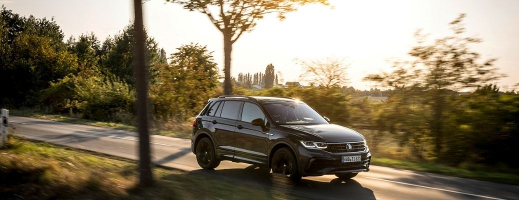 2022 Volkswagen Tiguan on road with sunlight mildly touching its surface