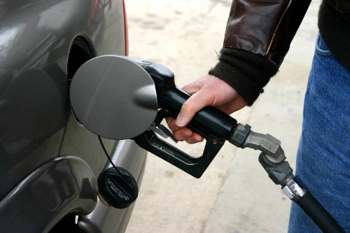 Hand using pump to fill fuel tank