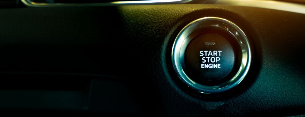 Closeup image of the start engine button inside a vehicle