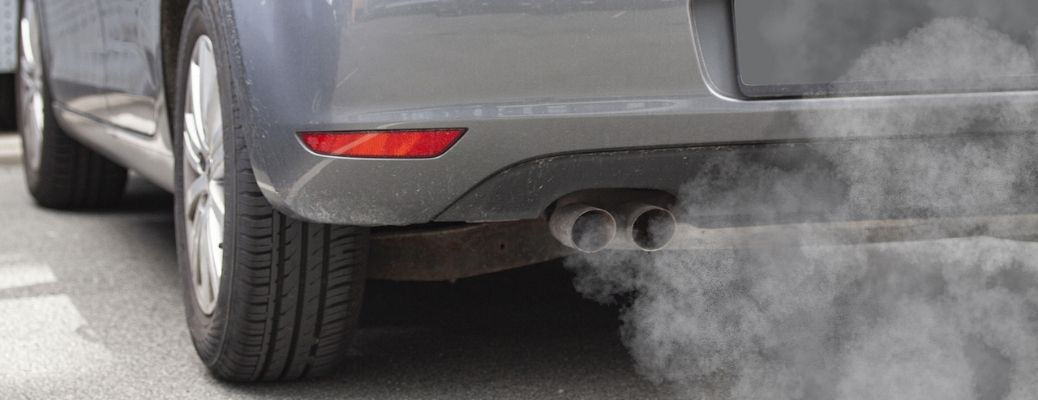 Image showing the tailpipe or a car's exhaust emitting smoke
